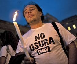 Un manifestante del No Usura Day (Credits Guido Montani-Ansa)