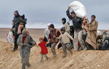 Rifugiati siriani entrano in territorio giordano