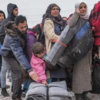 Migranti_corridoi-umanitari-CMYKjpg