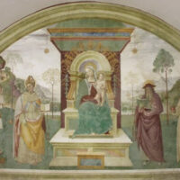La lunetta con l'affresco della Madonna in trono fiancheggiata da santi